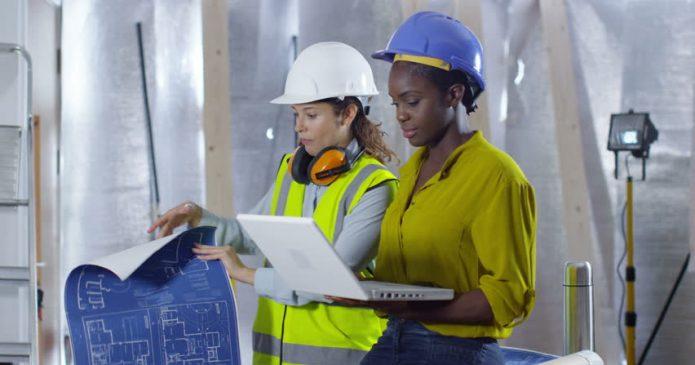 two women viewing construction docs