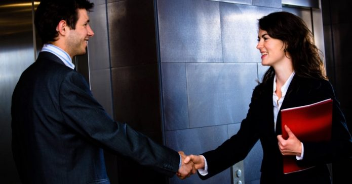 two people shaking hands in elevator